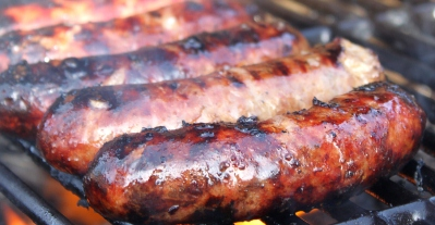 Sausages Sizzling on a BBQ Grill