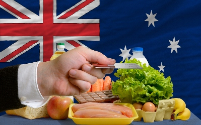 Australians are Paying Less for Groceries - Groceries with the Australian Flag & A Credit Card
